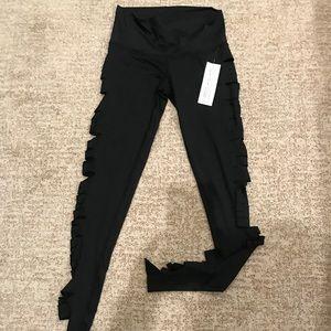 Teeki ripped sides small NWT women's leggings